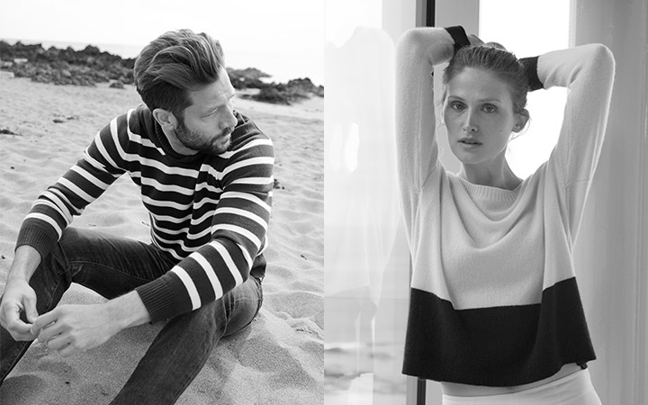 johnstons of elgin black and white image of models wearing cashmere jumpers